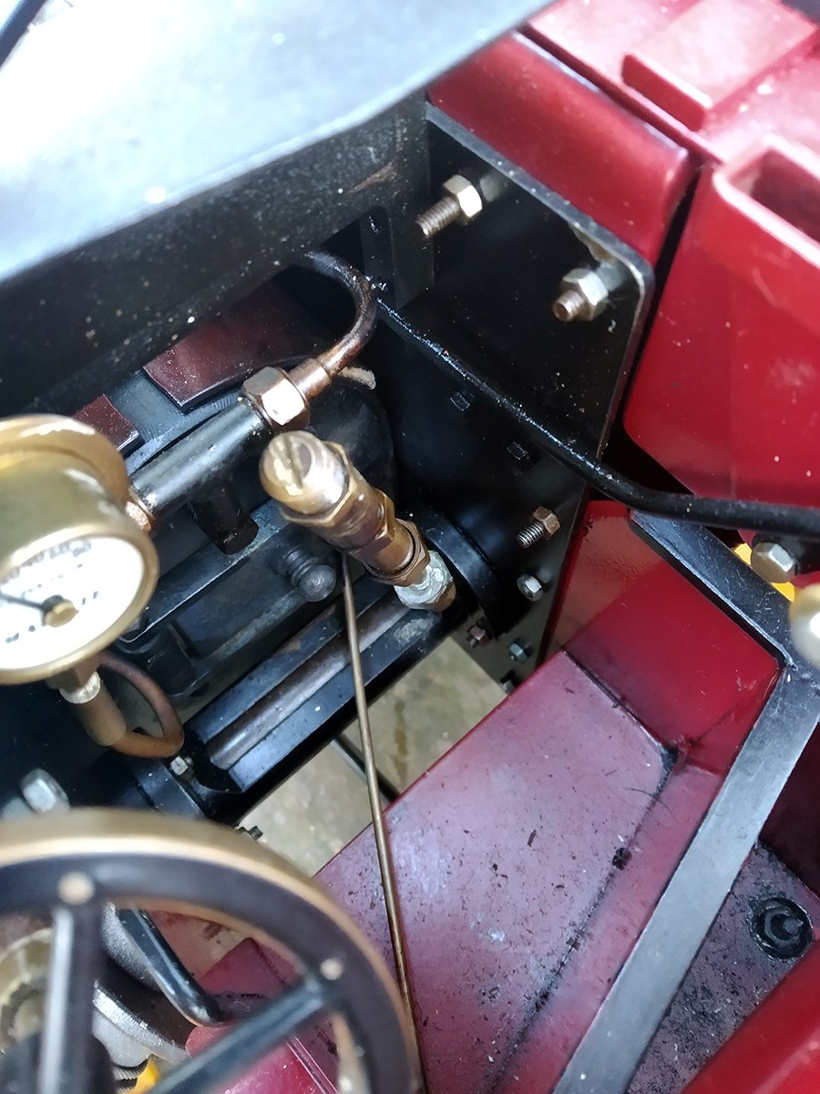 The safety valve on top of the water gauge.  NB.  the brass rod to keep the firebox door shut.